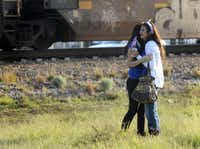 """Parade participants react after a trailer carrying wounded veterans in a parade was struck by a train in Midland, Texas, Thursday, Nov. 15, 2012. """"Show of Support"""" president and founder Terry Johnson says there are """"multiple injuries"""" after a Union Pacific train slammed into the trailer, killing at least four people and injuring 17 others. (AP Photo/Reporter-Telegram, James Durbin)James Durbin - AP"""