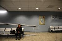 Irma Escobedo waits for the morning tram at Las Colinas Area Personal Transit System's Tower 909 Station.Rose Baca