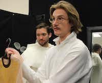 """Designer Austin Scarlett (right) consults with Fort Worth Opera production director Kurt Howard (not seen) on a costume for Ian McEuen, who will play Padre in the FW Opera's world-premiere production of """"With Blood, With Ink,"""" in April 2014.Joy Tipping/Staff"""