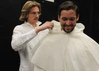 """Designer Austin Scarlett (left) works on a costume for Ian McEuen in """"With Blood, With Ink,"""" in April 2014 for the Fort Worth Opera.Joy Tipping/Staff"""
