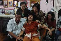 Risman Siregar (L) comforts his wife Erlina Panjaitan (C), parents of Firman Chandra Siregar, a 24-year-old passenger of Malaysia Airlines flight 370 that went missing on March 8, in Medan on March 9, 2014. Malaysia is investigating four names on the flight manifest of the airliner with 239 people aboard that vanished, as it probes a possible terror link, the Transport Minister Hishammuddin Hussein said.