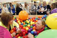 """From L to R, Marilu Cleaver (left) and Mary Jo Cater, both Addison residents, talk inside a ball pit at a city event Jan. 23. The """"dot pit"""" was a part of Addison's rebranding campaign, intended to connect people and build friendships.Staff Photo by KYE R. LEE - DMN"""
