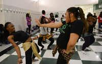 Diamonn Graham-Williams (left) and Jaizmone Birdine, members of the Berkner African Dance Crew, rehearse during an after-school practice in the hallways of L.V. Berkner High School. This semester, Berkner chemistry teacher and Nigerian native Adaobi Umeaku, held tryouts to start an official dance crew, the only group of its type currently active in Richardson ISD. Eleven of the 25 girls that auditioned were selected to join the crew.Photos by Rose Baca