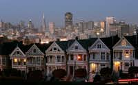 ORG XMIT: *S0423192568* The Painted Ladies, a row of historical Victorian homes, underscore the San Francisco skyline in a view from Alamo Square, Monday, May 12, 2008.(AP Photo/Marcio Jose Sanchez)