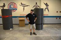 Matthew Woody stands in his new Pro Martial Arts gym in Frisco on May 23, 2014. The gym will offer a 12-week bullying prevention program, named Armor, developed for children ages 3 and older.Rose Baca - neighborsgo staff photographer