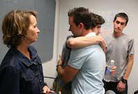 Catherine Swiatocha and her son Jonathan (right) watched Matthew Ayers hug Davy Swiatocha during an emotional meeting 10 years after a car accident a drunken Ayers caused.