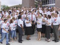 """To show their love and appreciation for Iden, about 700 students and faculty members surprised the retiring principal in 2008 by wearing T-shirts the read """"I love Dr. Bob.""""DMN file photo"""