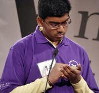 """Lokesh Nagineni spells out a word in his hand during the 56th annual Dallas Morning News Regional Spelling Bee in March. He won the bee after correctly spelling the word """"mastoiditis.""""DMN file photo - Staff Photographer"""