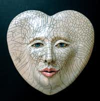 """""""Heart Lines,"""" ceramic raku mask by Louise Murdock, part of the """"El Corazon"""" (accent on the second o) exhibit at the Bath House Cultural Center, Feb. 1-March 1, 2014."""