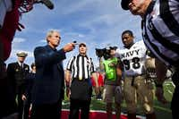 Former President George W. Bush flipped the coin before the SMU-Navy game on Nov. 12, 2011