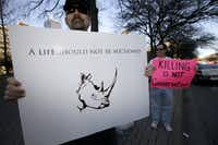 File photo from 2014 of Bob Fretwell of Mesquite protesting outside the Dallas Convention Center where the Dallas Safari Club is holding a weekend show and auction. A permit to shoot an endangered black rhinoceros in Africa was up for bid. (AP Photo/Tony Gutierrez)