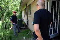 Jeff Cardile, an inspector for Total Air & Heat Co., speaks with Robert Munez after the installation of his new air conditioning unit. Munez's Farmers Branch neighborhood was ranked to be the best quality per dollar in the Carrollton, Farmers Branch and Addison areas, according to an analysis by The Dallas Morning News.