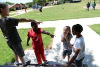 Neighborhood kids (from left) R.J. Jackson, 9, Jaelon Dennis, 9, Amie Jackson, 7, and Jaidon Dennis, 9, get ready to play a game of tag at Raldon-Lake Cities Park in Serendipity Village. Neighborhoods Serendipity Village, Lakewood North and Lakeland Terrace ranked to be the best quality per dollar in the Lewisville and Flower Mound areas, according to an analysis by The Dallas Morning News.