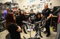 Students in Garland ISD's after-school program repair bicycles work together.ROSE BACA/neighborsgo staff photographer