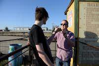 Matthew Masek, 30 (right), and Jordan Corn, 15, get into a playful argument before riding go karts at Ellen's Amusement Center.Photos by ROSE BACA