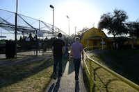 Masek and Jordan walk back to the parking lot after riding go-karts at Ellen's Amusement Center.Photo by ROSE BACA