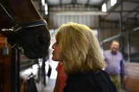 Head trainer Lisa Blackmon leans in to kiss Irnas before a ride. Blackmon has spent her life studying and showing horses. She has won multiple dressage and equestrian horse of the year awards.Rose Baca - neighborsgo staff photographer