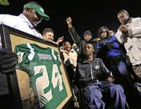 Family and friends surrounded Corey Borner at Eagle Stadium during a halftime ceremony as his DeSoto High School jersey was retired Thursday night.