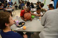 D.J. Baptiste, 10, rests his head on a basketball during snack time at the Boys and Girls Clubs of Collin County's Plano branch.Rose Baca - neighborsgo staff photographer