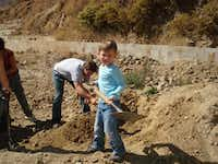 Elijah McMillan digs up dirt to be used to make stoves during a service trip to Peru.Photos submitted by CATHERINE GREENBERG 219,4,200