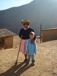 Elijah visits with a new friend in Peru.Photo submitted by CATHERINE GREENBERG