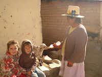 Isabella and Elijah visit with new friends while in Peru.Photo submitted by CATHERINE GREENBERG