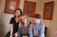 Catherine Greenberg, center, of Far East Dallas, has taken her children, Isabella McMillan, 14, and Elijah McMillan, 11, on service trips to other countries since they were 7 and 5, respectively. Now, she's working to help other young people gain similar experiences through her organization Bright Light Volunteers, which will launch a video contest March 30.Photo by RUTH HAESEMEYER  -  Special Contributor