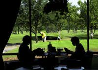 A golfer works on his short game, while diners have a quite lunch. These are just some of the activities at Brookhaven Country Club.