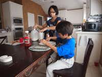 Paris Roberson, 14, left, and her brother Preston, 9, enjoy breakfast May 18. They are two of Mark and Marcie Roberson's three children. The family lives in Stafford Estates, found in a recent study by The Dallas Morning News to be the best suburban neighborhood in southern Denton County.
