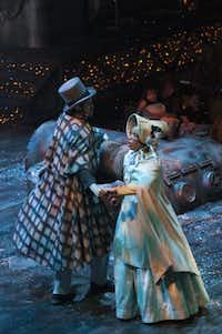 """Alex Organ (young Scrooge), Tiffany Hobbs (Lucy), perform in Kevin Moriarty's adaptation of """"A Christmas Carol"""" at the Dee and Charles Wyly Theatre on Sunday, Nov. 24, 2013."""