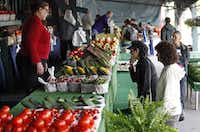 Fatima Amaroufi (left) of Allen, waits on Debbie Engell (right) of Plano and Toni Nesmith of Plano as she makes up her mind at the the Collin County Farmers Market in Plano which was having their opening day on Saturday, April 20, 2013.Stewart F. House - Special Contributor