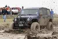 Colby Smith churns through the mud while competing at the Nevada Mud Pits. The Pits include two, 25-foot-wide by 200-foot-long mud pits.Stewart F. House - Special Contributor