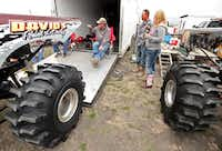 (Left to right) Jimmy Moreland of Ivanhoe, Brent Henshaw and his wife Jennifer of Denison gather around the trucks before vehicles started competing at the Nevada Mud Pits on March 22.Stewart F. House  -  special contributor