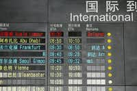 The arrival board at the International Airport in Beijing shows a Malaysian airliner is delayed from Kuala Lumpur.Ng Han Guan - AP