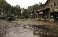 Mud from flooding is shown covering the main street in Estes Park, Colo., on Sept. 15, after water and debris swamped the town.