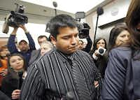 Erick Muñoz 's attorneys escorted him through a throng of journalists after Friday's court hearing in Fort Worth. A judge agreed that life support should end for his brain-dead, pregnant wife. John Peter Smith Hospital could still appeal the ruling.Tom Fox - Staff Photographer