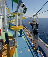 Located adjacent to the WaterWorks water park aboard Carnival Sunshine is SportSquare, an expansive outdoor recreation complex featuring a ropes course, jogging track, two-level nine-hole miniature golf course, a basketball court, and ping-pong, foosball and pool tables.