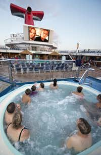 Guests have the best seat in the house as they view the massive screen Carnival's Seaside Theatre, a 270-square-foot poolside LED screen on Carnival Sunshine that shows movies, concerts, sporting events and other programming.