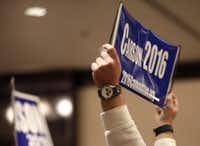 A Ben Carson supporter holds a sign while Carson speaks at a town hall meeting hosted by the NE Tarrant Tea Party at the Westin Dallas Fort Worth Airport in Irving, Texas on Feb. 27, 2016. (Rose Baca/The Dallas Morning News)