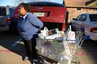 Jacqueline Eaton loads groceries into her vehicle at the Cedar Hill Food Pantry on Jan. 3. The nonprofit recently put a 4-acre piece of property along South Clark Road under contract. The plan is to erect a 12,000-square-foot building by the end of the year that would unite the pantry and its thrift store, New2You, under one roof.ROSE BACA/neighborsgo staff photographer