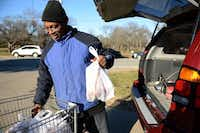 Gregory George loads groceries into his vehicle at the Cedar Hill Food Pantry on Jan. 3, 2014. The nonprofit recently put a four-acre piece of property along South Clark Road under contract. The plan is to erect a 12,000-square-foot building by the end of the year that would unite the pantry and its thrift store, New2You, under one roof.ROSE BACA/neighborsgo staff photographer