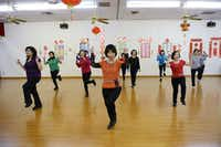 Instructor Juliet Lam (center) leads Asian woman in a line dancing class on Feb. 11 at the Dallas Chinese Community Center in Richardson. The nonprofit center has been a refuge for Asian immigrants in the Dallas area for almost three decades.Rose Baca