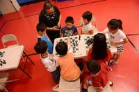 Students play chess at HuaYi Education, a Chinese school offering supplemental education and after-school programs for many of Plano's Asian students. There is supervised homework, lessons in Chinese language, math, reading and chess programs.