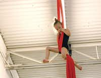 Laruen Rigdon, the youngest member of the Dallas Cirque Theatre, followed in her sister's acrobatic footsetps; joining the troupe the following semester.
