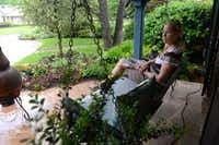 Darleen Robertson sits on the front porch of her home in Hillcrest Forest, which was rated the best for city dwellers in the Park Cities and North Dallas area.