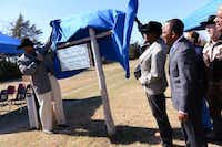 Sean Johnson, director of parks and recreation for the city of Lancaster, and Cleo Hearn (right) unveil the sign at the recently named trailhead of the Cleo Hearn Equestrian Trail.Rose Baca - Neighborsgo