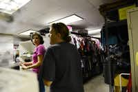 Joan Lyons (left) gives a tour to Lori Dardan, a PTA president, during The Carrollton-Farmers Branch ISD Council PTA's open house at the district's Clothes Closet. The closet provides clothes to the district's students on a referral basis. (Rose Baca/neighborsgo staff photographer)ROSE BACA