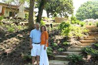 Bill and Julia Koch reconstructed their home, but also changed the entire landscaping in the backyard - creating steps that go down to the flowing creek below.