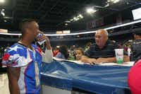 Will Cole visits with a fan after the Texas Revolution's loss to the Tri-Cities Fever on May 17 in Allen. The Revolution play host to the Sioux Falls Storm at 7 p.m. Saturday at the Allen Event Center.Staff photo by REBECCA STUMPF/DMN