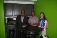 Dennis Coleman, Donovan Coleman and Ashley Daly stand in what's called the Green Room, a general gathering area inside the Lucy Hughes residence hall at Paul Quinn College.Loyd Brumfield - neighborsgo staff